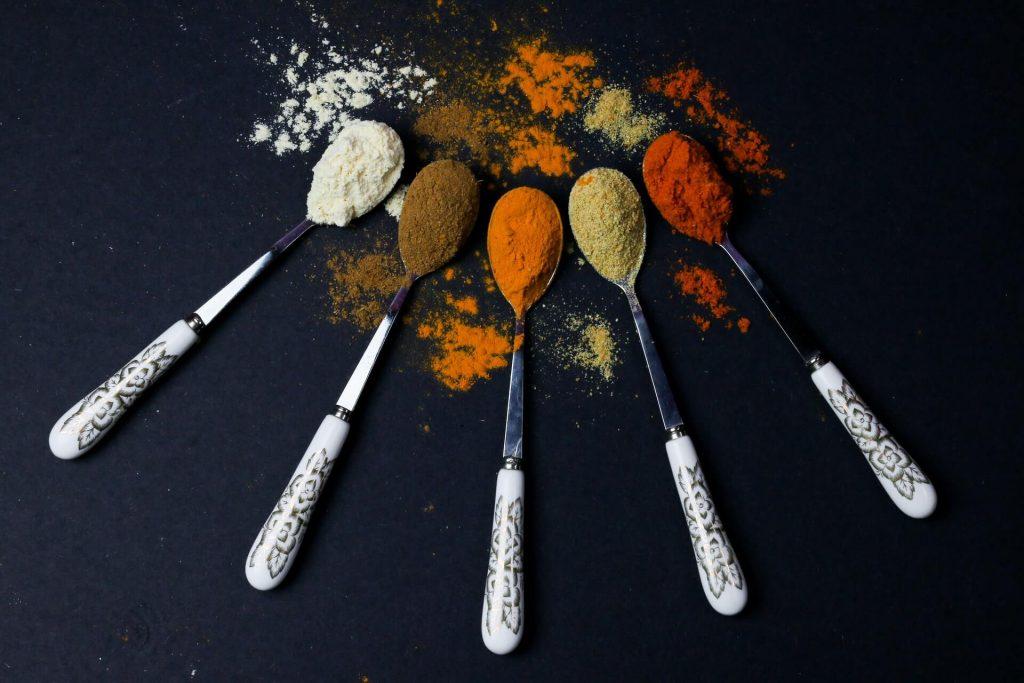 Five spoons full of different healthy seasonings