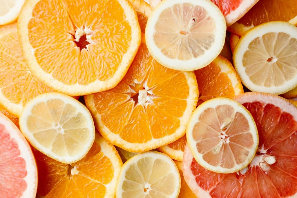 Circular slices of lemons, grapefruit, and oranges in different sizes