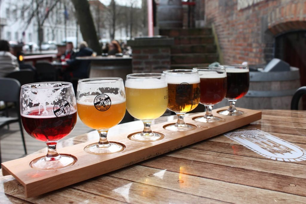 Six glasses of beer with different beer varieties