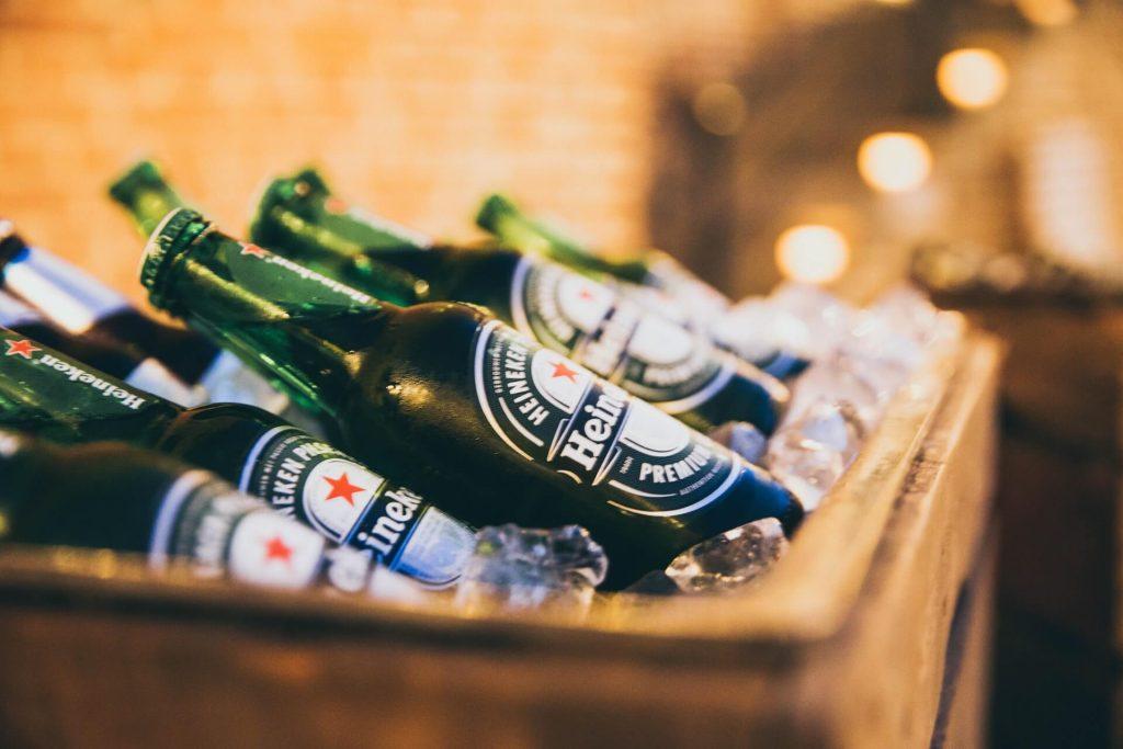 bottles of Heiniken beer in ice